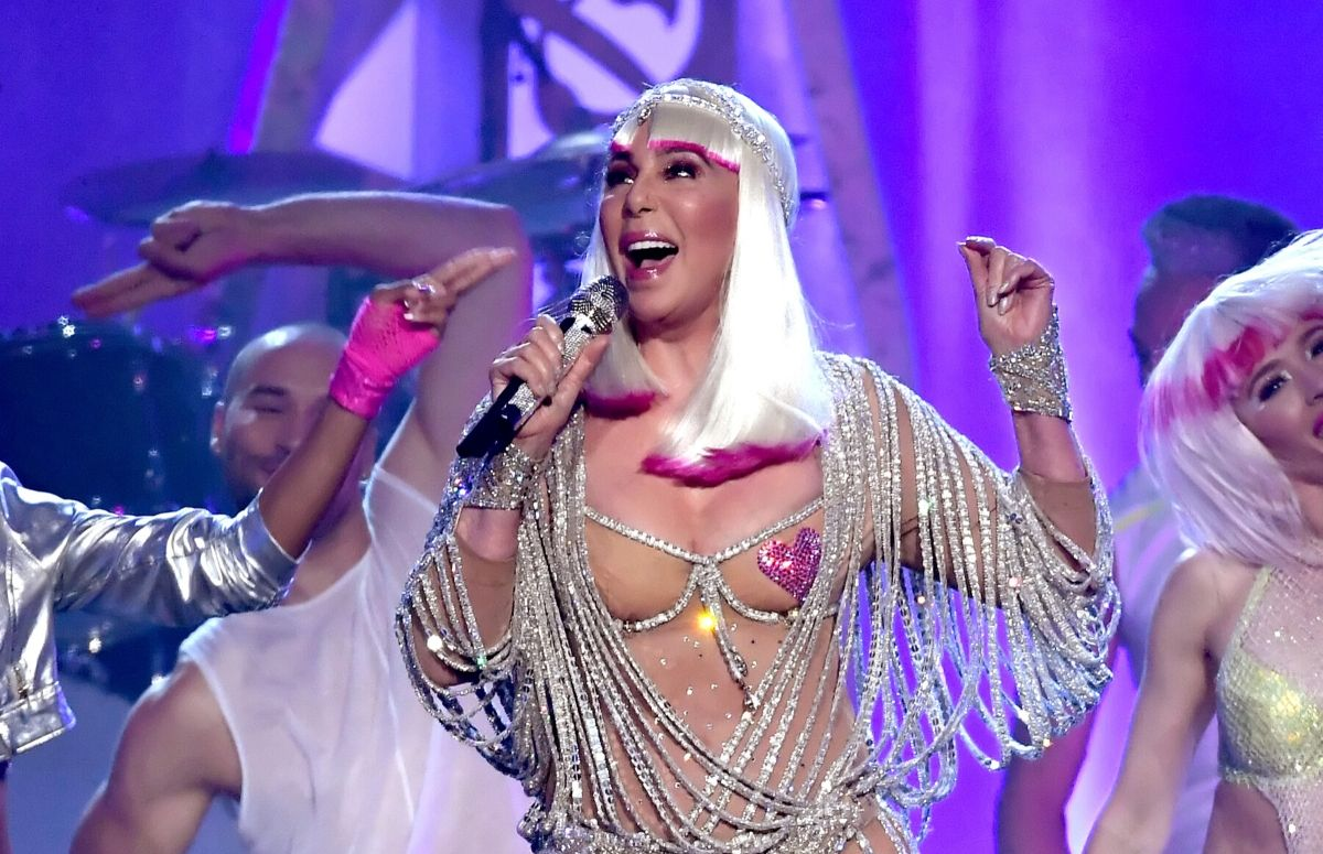 Cher performing at the 2017 Billboard Music Awards wearing a beaded, string dress and pasties