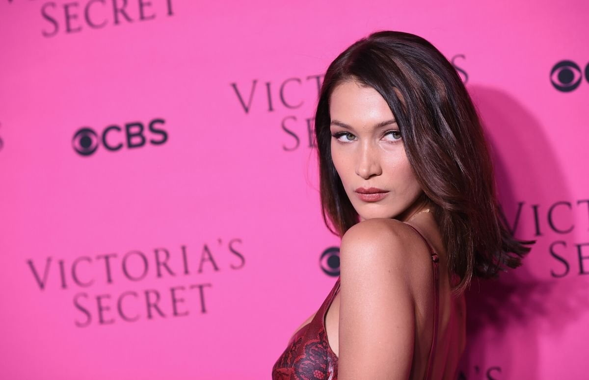 Bella Hadid wearing a dark pink top on the red carpet
