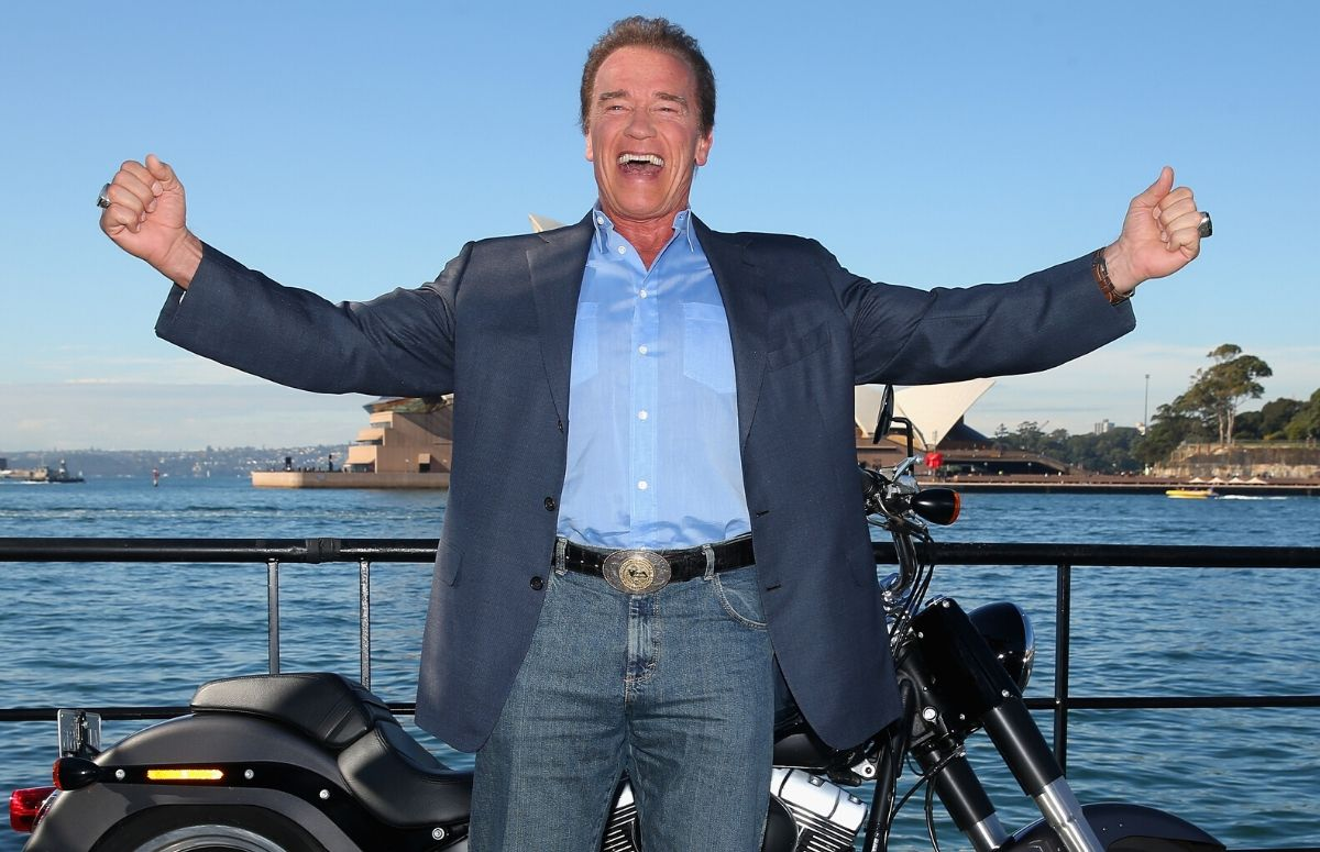 Arnold Schwarzenegger, wearing a suit jacket and jeans, at the Terminator:Genisys Sydney, Australia photo call