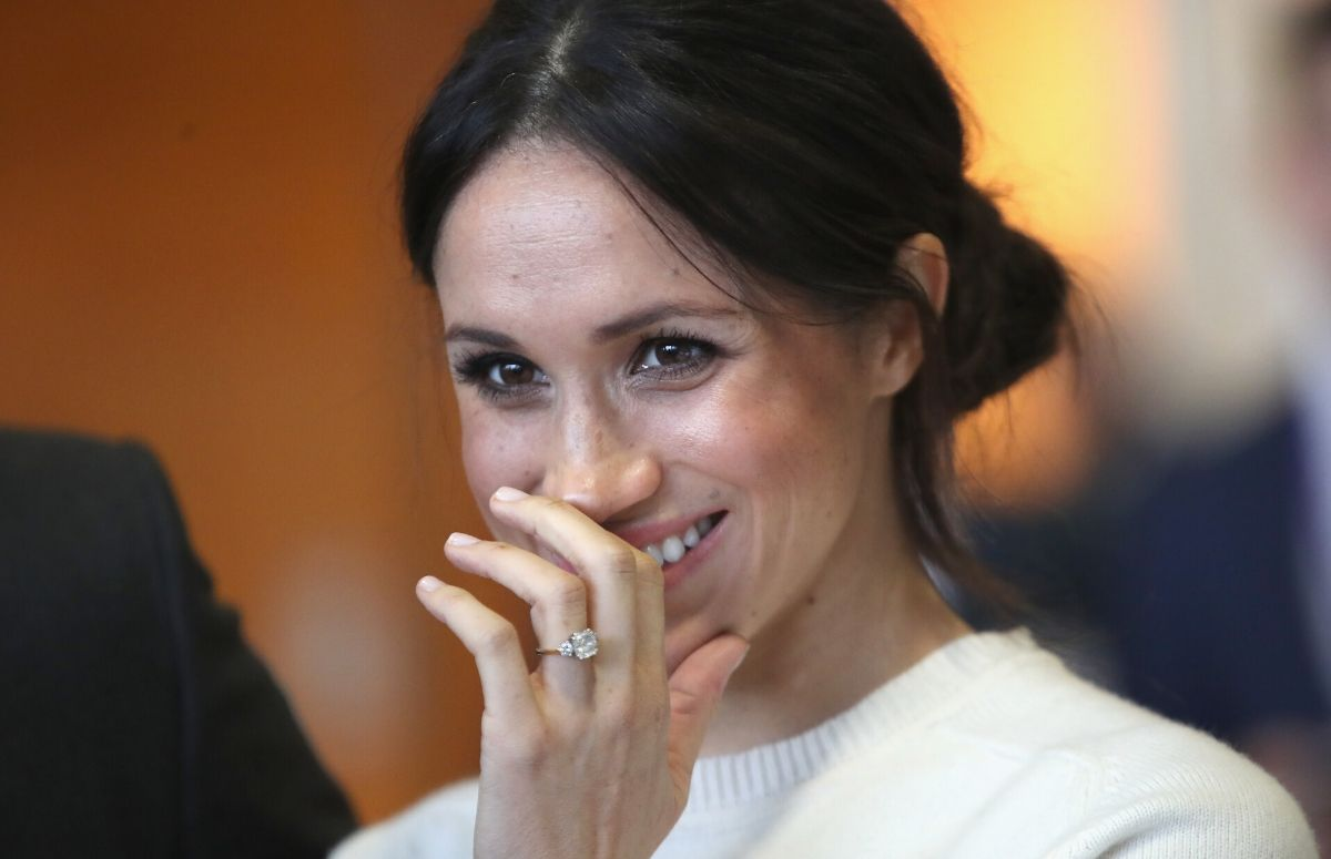 Meghan Markle wearing a white sweater during a visit to Northern Ireland