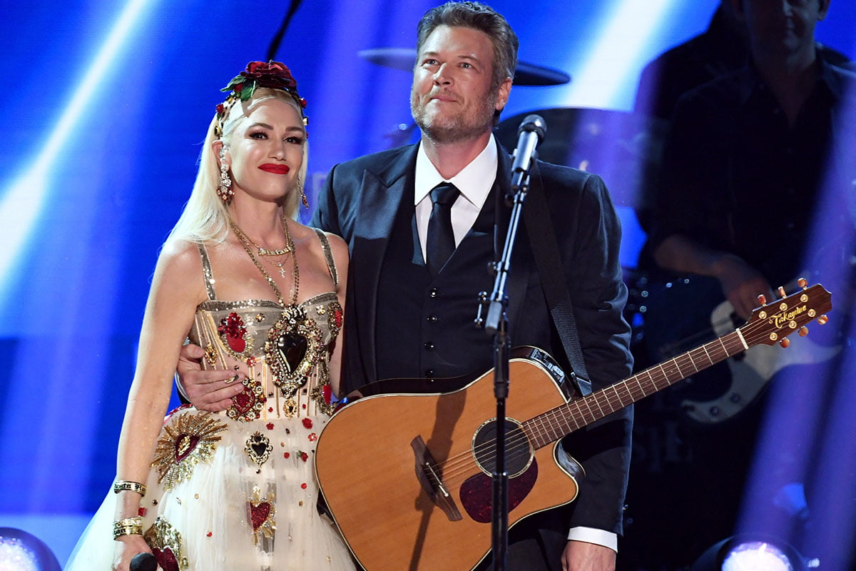 Gwen Stefani and Blake Shelton performing together on stage.