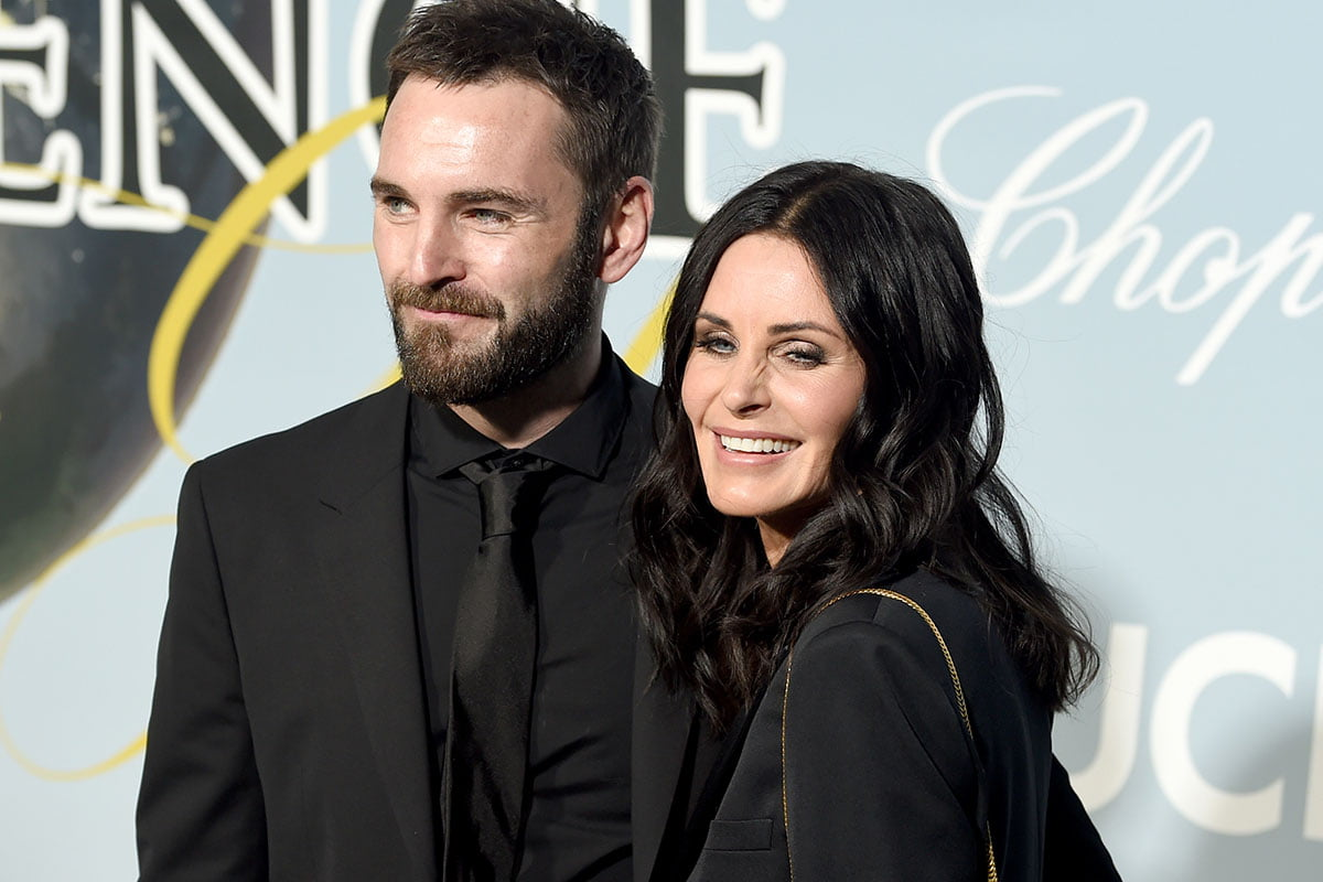 Johnny McDaid and Courteney Cox both wearing black together on a red carpet