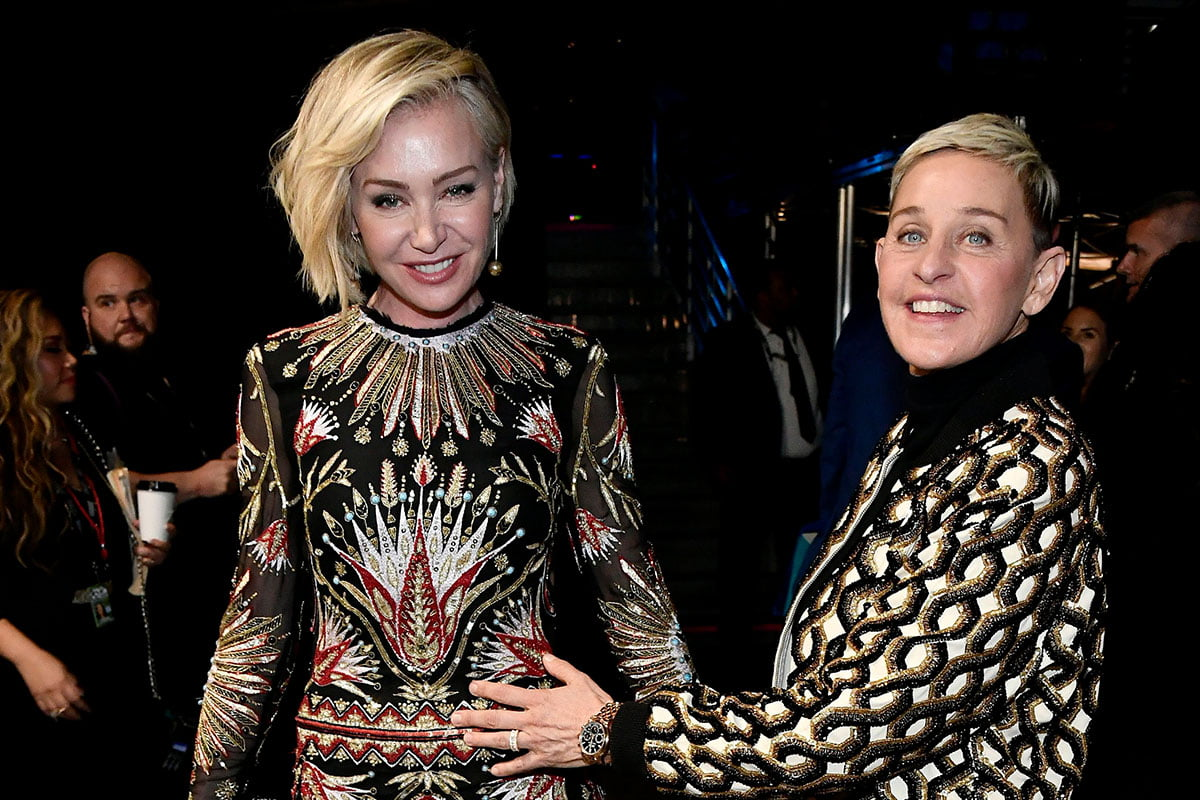 Portia de Rossi and Ellen DeGeneres posing with each other