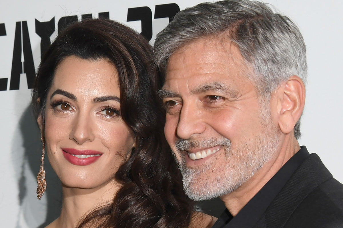 Up=close shot of George Clooney and Amal Clooney.