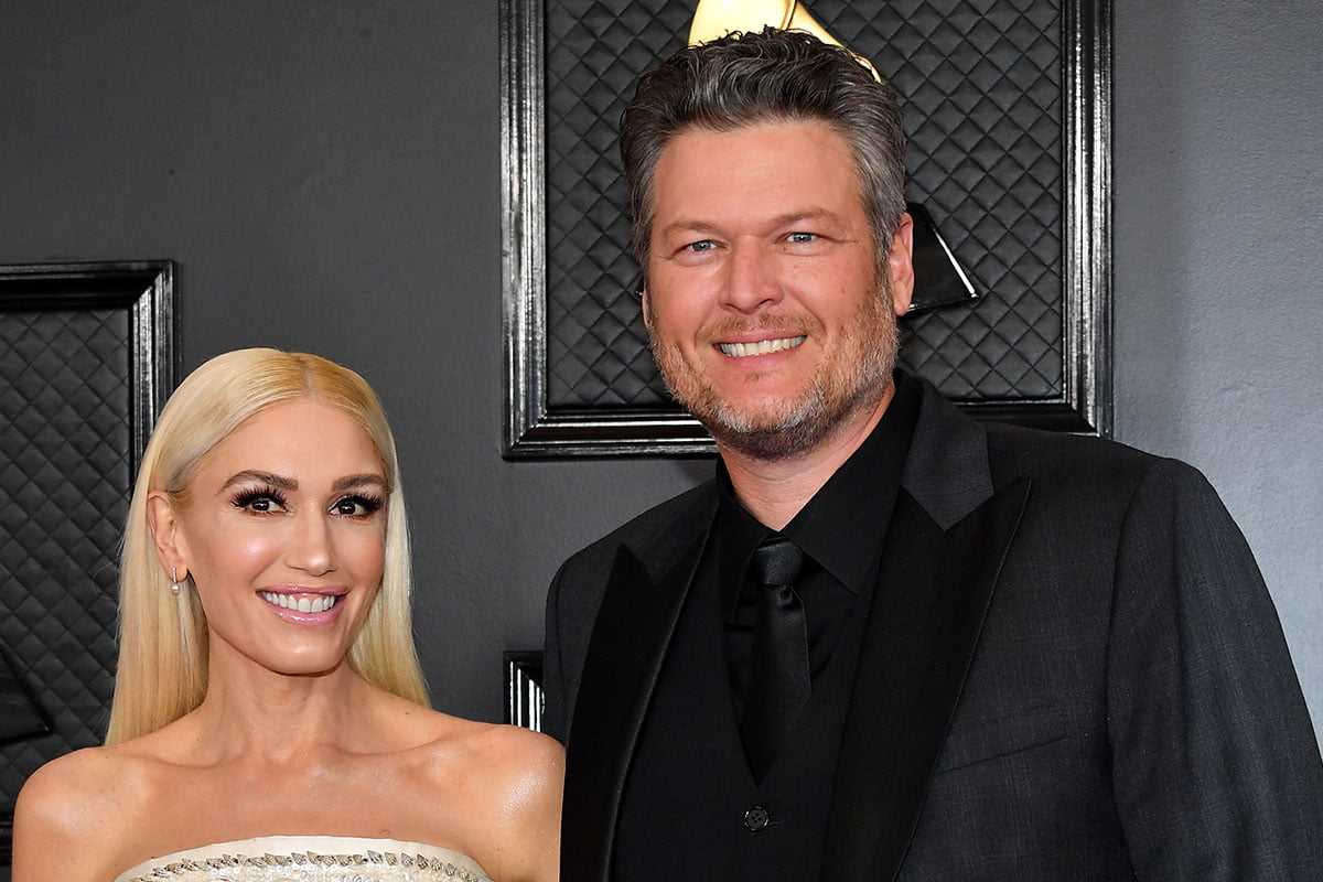 Gwen Stefani on the left, Blake Shelton on the right, together at a red carpet event.