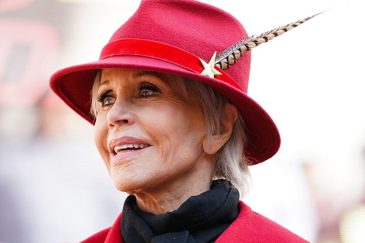 Jane Fonda wearing a red hat.