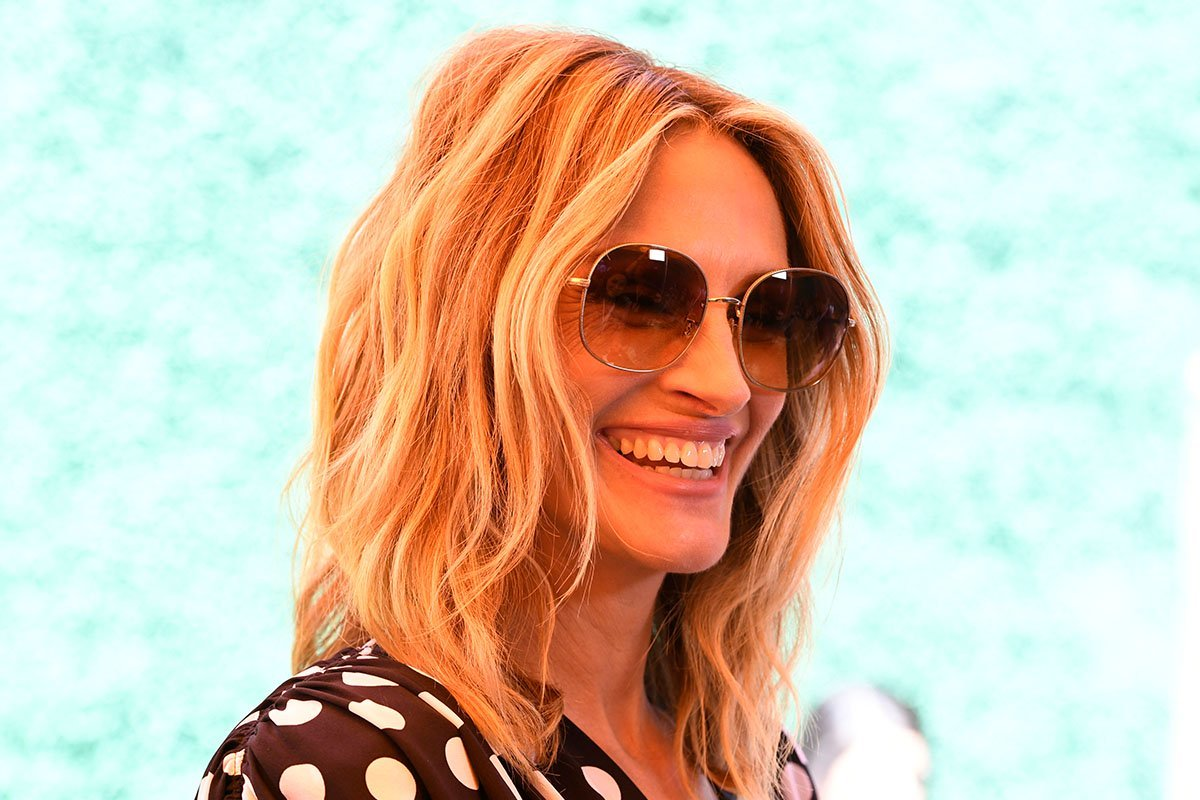 Julia Roberts smiling and wearing sunglasses in 2019.