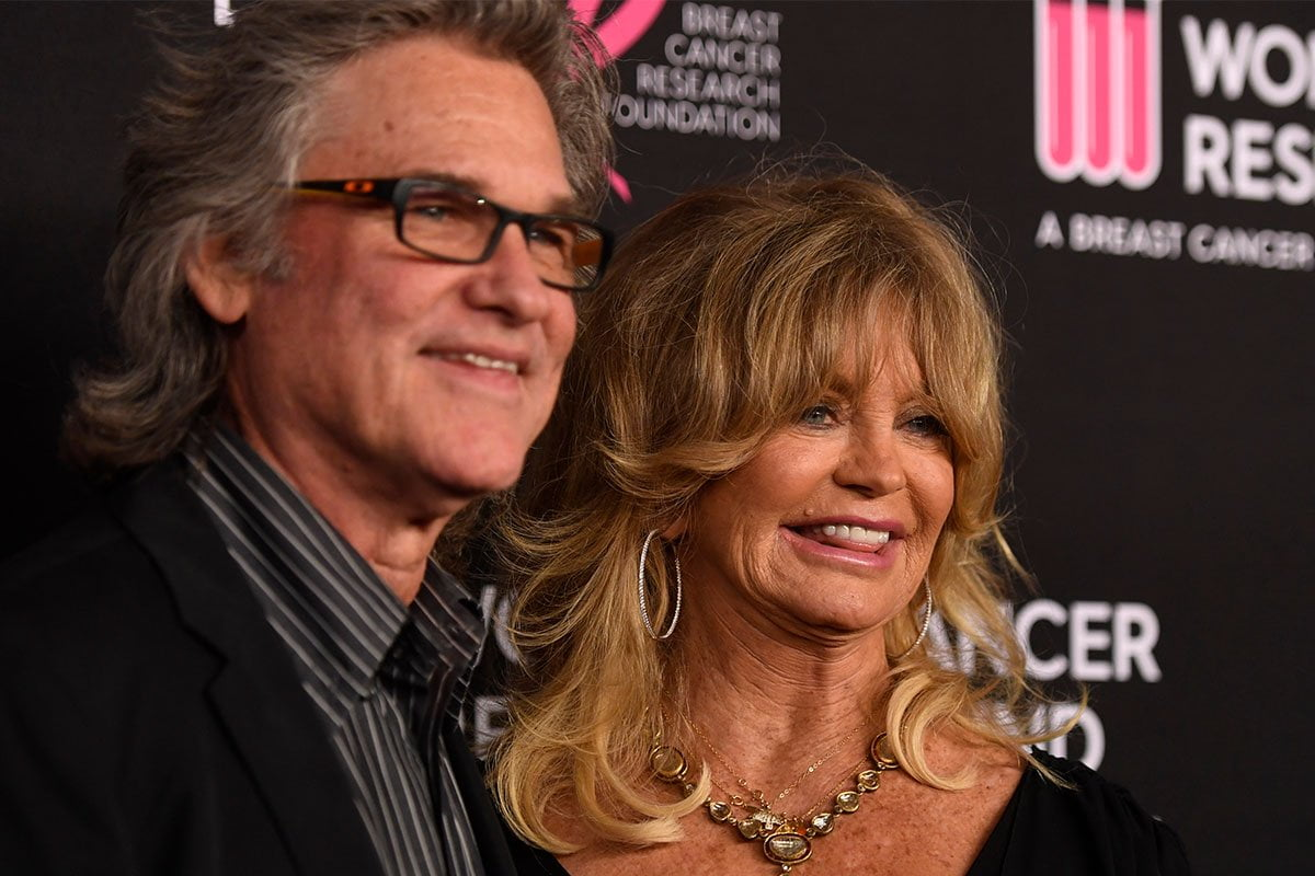 Kurt Russell and Goldie Hawn smiling together at a charity event.