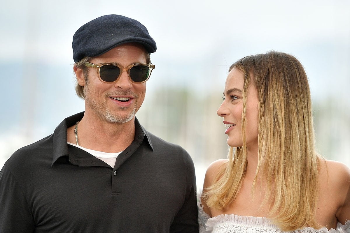 Margot Robbie, on the right, looking at Brad Pitt