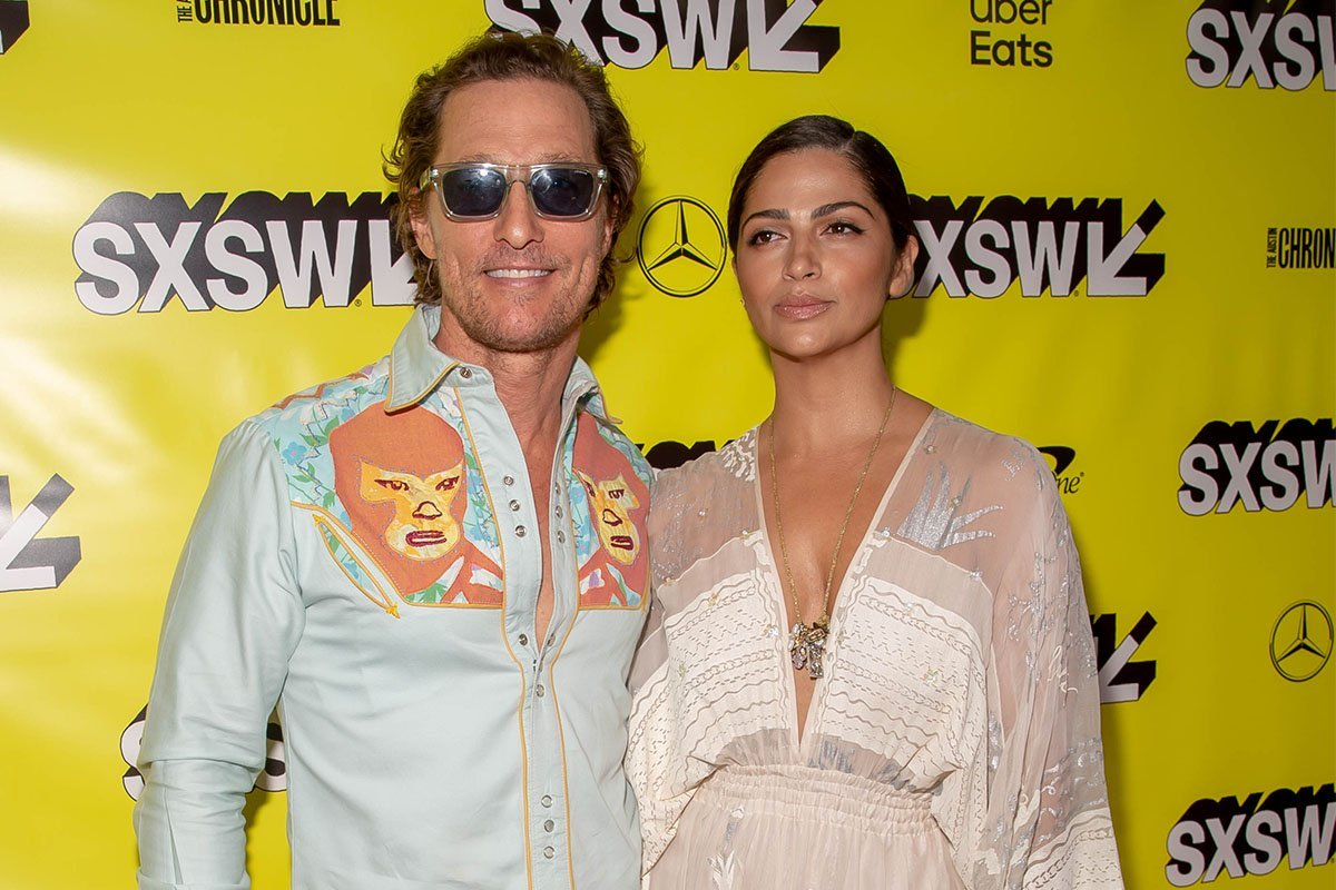 Matthew McConaughey and his wife at a red carpet event.