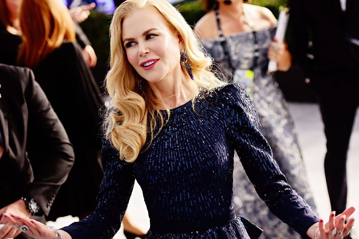 Nicole Kidman smiling and tilting her head in a glittery dress