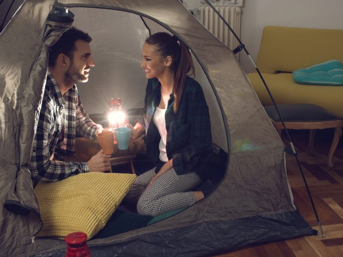 quarantine anniversary ideas, couple camping inside date night at home