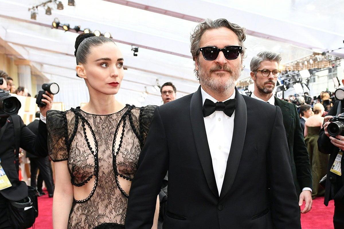 Rooney Mara and Joaquin Phoenix holding hands at the Oscars