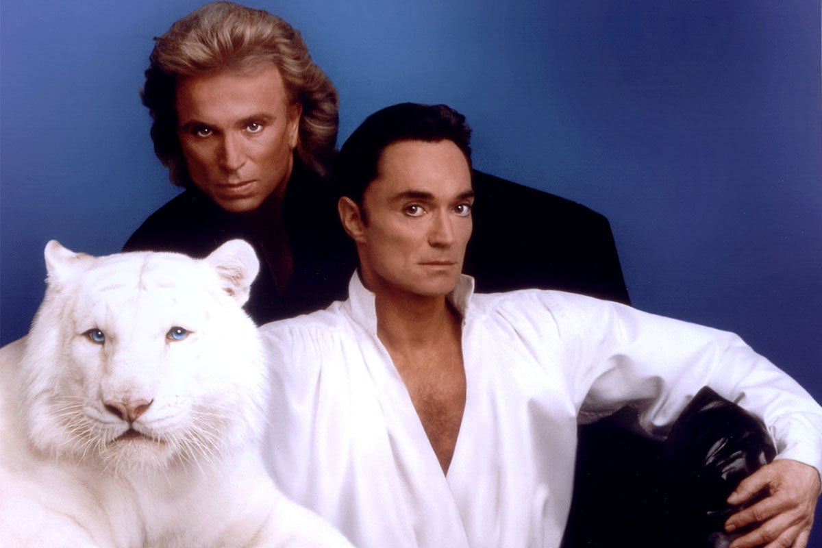 Siegfried And Roy and one of their white tigers in their heyday.