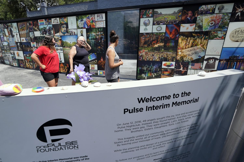 Visitors at Pulse Nightclub's interim memorial in Orlando