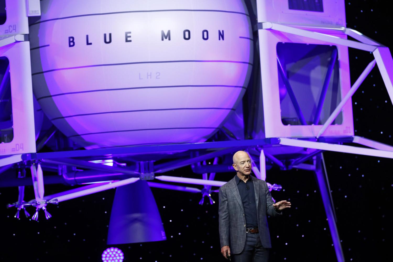 Jeff Bezos speaks in front of a model of Blue Origin's Blue Moon lunar lander