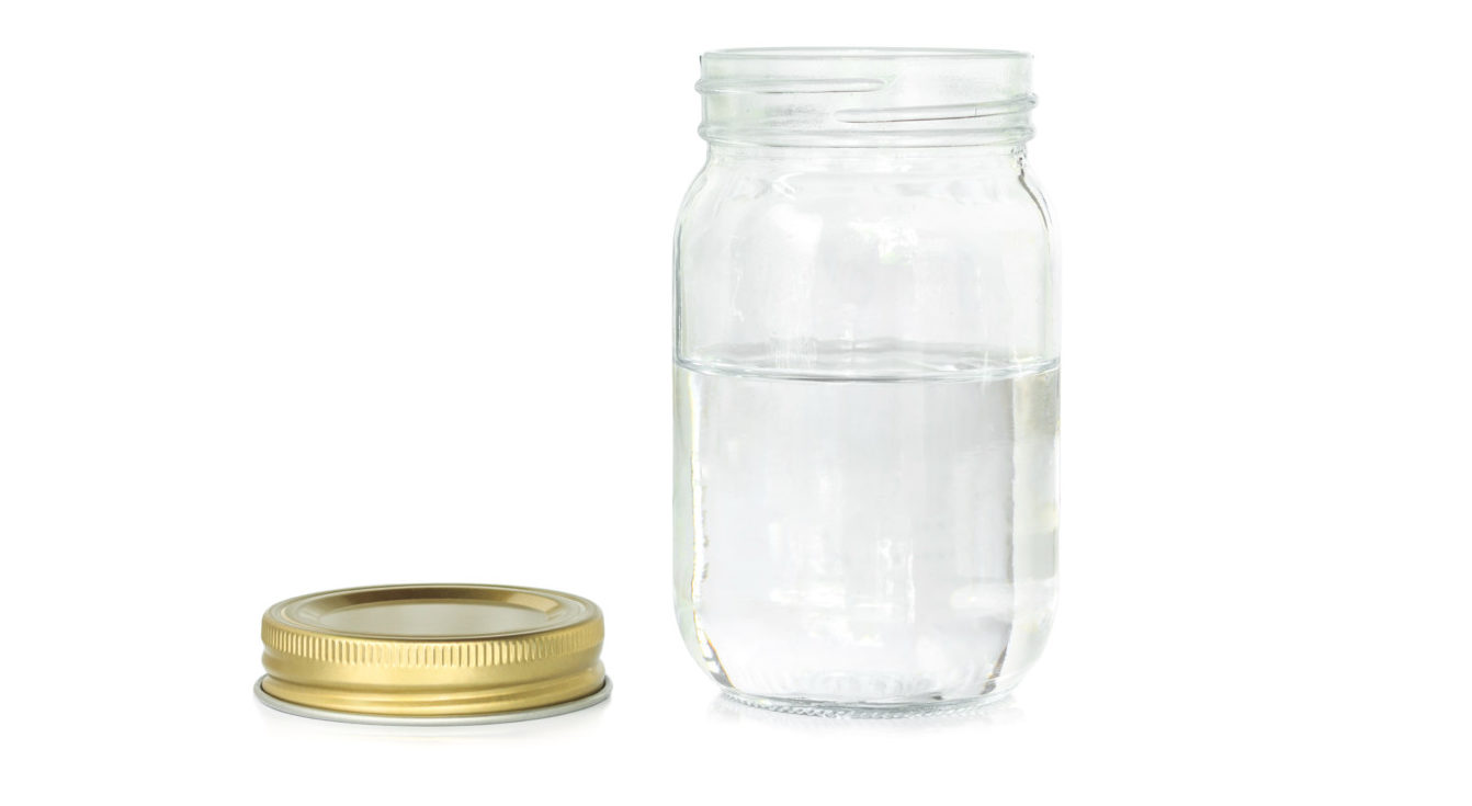 Water in a mason jar with lid off